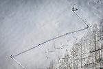 A backcountry skier hikes off piste near the site of a small avalanche at Canyons Resort, Wednesday, Dec. 19, 2012