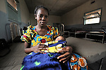 Marie Ambaye, 22, holds her newborn son, Kasongo, soon after giving birth in the United Methodist Hospital in the village of Wembo Nyama, DR Congo.