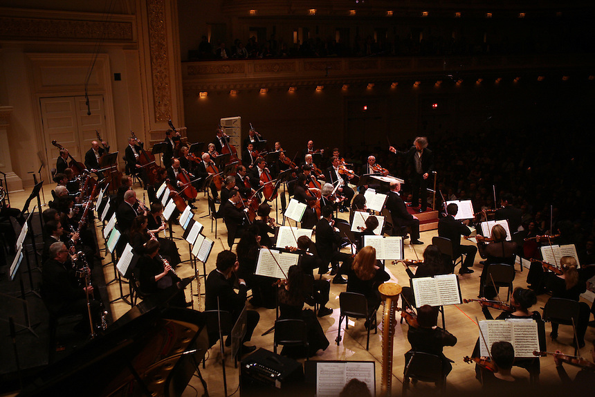 Fans wave green hankerchiefs to show support at the beginning of the performance Music for a Time of War by Oregon Symphony and Music Director Carlos Kalmar at the Spring for Music festival at Carnegie Hall in Manhattan, New York on May 12, 2011. .