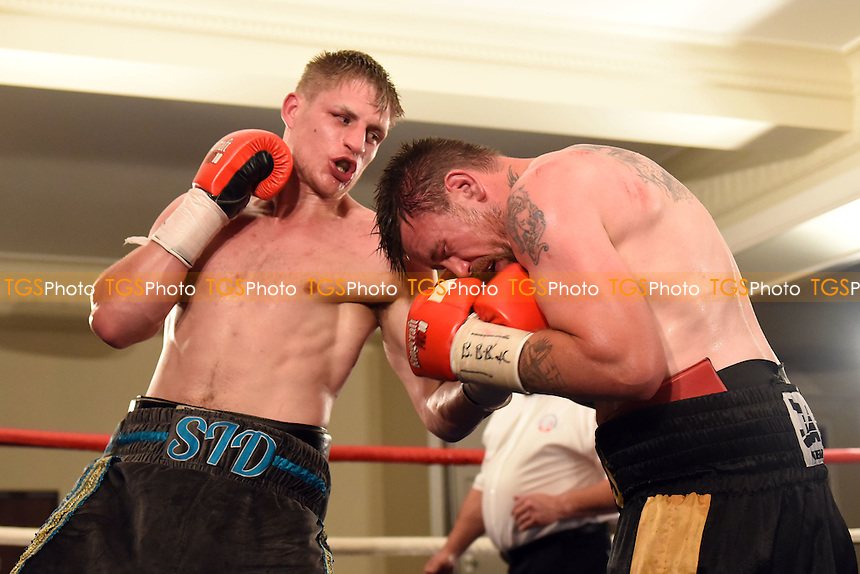 Simon Barclay (grey/blue shorts) defeats Mickey Steeds during a Boxing show at the Rockingham Forest Hotel, Corby, England on 11/09/2015
