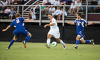 Winthrop University Eagles vs the Brevard College Tornados at Eagle's Field in Rock Hill, SC.  The Eagles beat the Tornados 6-0.  Pietro Bottari (21) moves between Caleb Hall (19) and Garrett Stone (8).