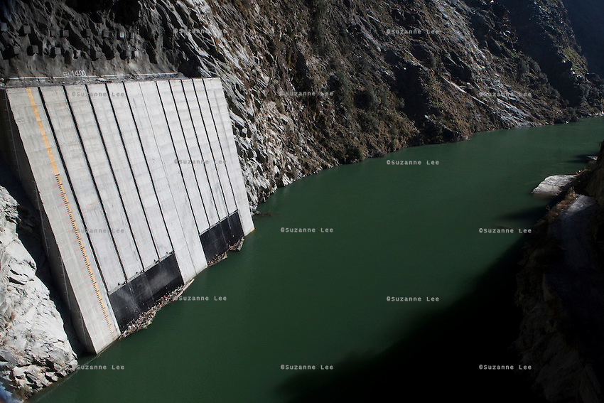 The newly-built NHPC hydroelectric dam, Chamera III, is filled by the narrow upper River Ravi in Chamba valley, Himachal Pradesh, India, on 22nd March, 2012. Photo by Suzanne Lee/CapaPictures for ALSTOM Hydro.