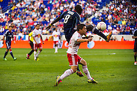 Dominic Oduro (8) of the Chicago Fire battles Connor Lade (16) of the New York Red Bulls for the ball. The Chicago Fire defeated the New York Red Bulls 2-0 during a Major League Soccer (MLS) match at Red Bull Arena in Harrison, NJ, on October 06, 2012.