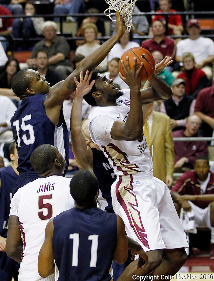 TALLAHASSEE, FL 11/12/10-FSU-ASU MBB 111210 CH-Florida State's Chris Singleton is defended by North Florida's Jerron Granberry during second half action Friday at the Donald L. Tucker Center in Tallahassee. The Seminoles beat the Ospreys 75-55..COLIN HACKLEY PHOTO