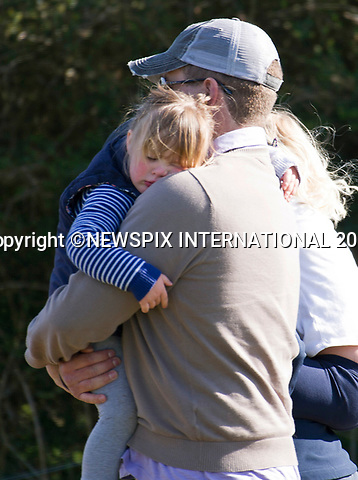25.03.2017; Gatcombe, UK: MIA TINDALL SLEEPS ON UNCLE PETER PHILLIPS' SHOULDER<br /> The running around with cousins Savannah and Isla at the Gatcombe Horse Trials has tired out 3-year-old Mia Tindall, who falls asleep in the arms of uncle Peter Phillips.<br /> The 2-day horse trials are held on Princess Anne&rsquo;s estate in Minchinhampton, Gloucestershire<br /> Mandatory Photo Credit: &copy;Francis Dias/NEWSPIX INTERNATIONAL<br /> <br /> IMMEDIATE CONFIRMATION OF USAGE REQUIRED:<br /> Newspix International, 31 Chinnery Hill, Bishop's Stortford, ENGLAND CM23 3PS<br /> Tel:+441279 324672  ; Fax: +441279656877<br /> Mobile:  07775681153<br /> e-mail: info@newspixinternational.co.uk<br /> Usage Implies Acceptance of OUr Terms &amp; Conditions<br /> Please refer to usage terms. All Fees Payable To Newspix International