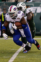 Buffalo Bills, Boobie Dixon, RB,  is tackled by New York Jets Muhammad Wilkerson, DL, during their NFL game at MetLife Stadium in New Jersey. 09.05.2014. VIEWpress