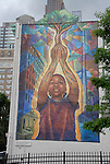 Modern mural art in Philadelphia, show one showing a child..Philadelphia, Pennsylvania, PA USA.  Photo copyright Lee Foster, 510-549-2202, lee@fostertravel.com, www.fostertravel.com. Photo 333-30884
