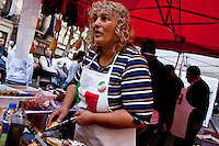 An immigrant resident prepare food while she celebrates the day of the immigrant Calabres in Buenos Aires, Argentina, April 14, 2013 Photo by Juan Gabriel Lopera / VIEWpress.