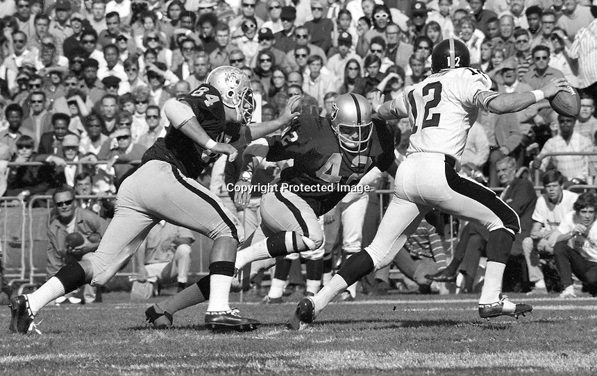 Raiders Tony Cline and Bill Laskey chase down Pittsburg quarterback Terry Bradshaw. (1970 photo by Ron Riesterer)