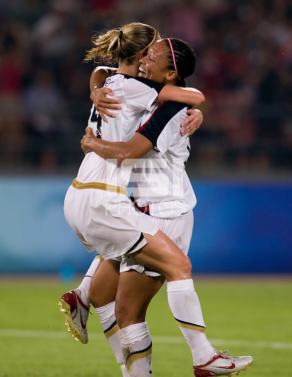 USWNT midfielder (16) Angela Hucles celebrates her goal with teammate (5) Lindsay Tarpley while playing at Worker's Stadium.  The USWNT defeated Japan, 4-2, during the semi-finals of the Beijing 2008 Olympics in Beijing, China.