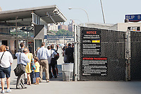 Ferry passengers enter New York Waterway Pier 11 - Wall Street ferry terminal during the afternoon rush hour