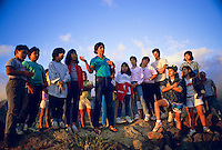 Polynesian voyaging canoe, Hokule'a, navigator, Nainoa Thompson talks to students about celestial navigation at heiau, Poka'i Bay, Waianae, Oahu.