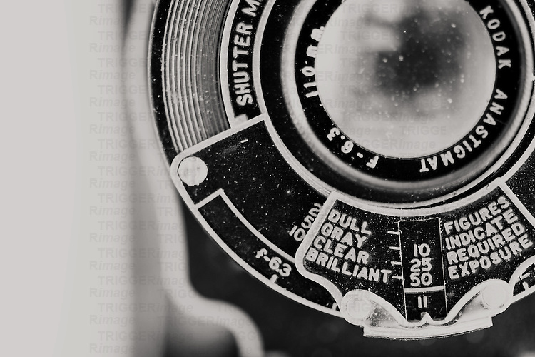 a macro shot of a vintage kodak camera in black and white
