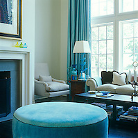 Bright tones of turquoise are set against more muted shades of eau de nil in this living room