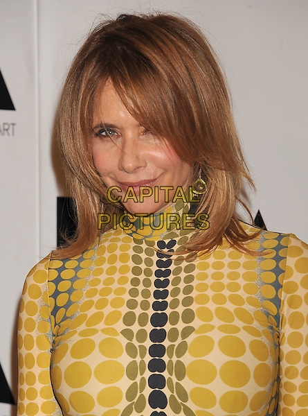 "Rosanna Arquette.The 2011 MOCA Gala ""An Artist's Life Manifesto"" With Artistic Direction From Marina Abramovic held at MOCA Grand Avenue in Los Angeles, California, USA,.12th November 2011..headshot portrait grey gray white black yellow  print purple circles.CAP/ROT/TM.© TM/Roth/Capital Pictures"