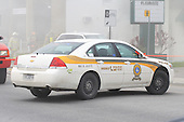White police car blocking street at the scene of a building fire. SQ Quebec provincial police car