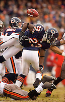 CHICAGO - DECEMBER 17:  Kick returner Devin Hester #23 of the Chicago Bears fumbles the ball on a kick off return against the Tampa Bay Buccaneers at Soldier Field on December 17, 2006 in Chicago, Illinois. The Bears defeated the Buccaneers 34-31. (Photo by Wesley Hitt/Getty Images)***Local Caption***Devin Hester