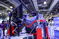 A man use a car simulator for the new 2017 Ford Raptor is exhibit at the 2015 New York International Auto Show in New York City. 04.06.2015. Kena Betancur/VIEWpress.