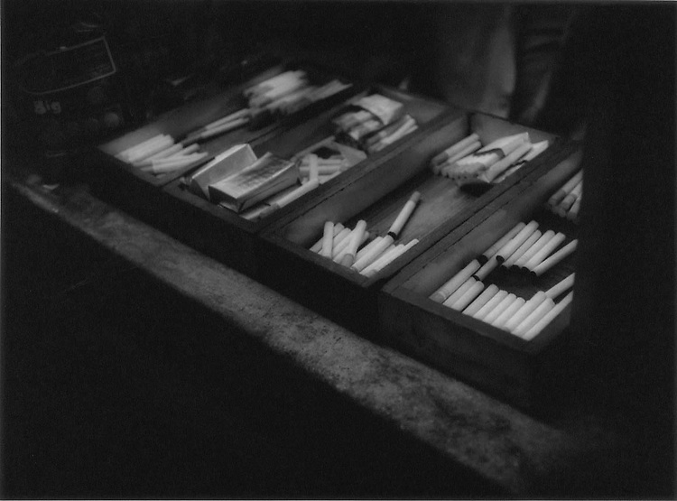 Smokes to go: Individual cigarettes for sale in Howrah Station, Calcutta, India.