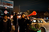 IRAQ, SULAIMANIYAH:  A reveler blows a plastic trumpet as he walks down Salim street in Sulaimaniyah...Revelers brought in the new year all across Kurdistan with shows of fireworks and enormous street parties...Photo by Metrography