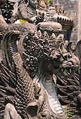 Close-up of a part of an ornate stone dragon sculpture.