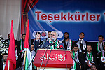 Senior Hamas leader Ismail Haniyeh gives a speech during a mass wedding ceremony in Gaza City, on May 31, 2015. Nearly 2000 Palestinian couples were married in a ceremony funded by the Turkish government and supported by the Hamas movement. Photo by Ashraf Amra