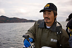 Hiromitsu Ito of Oh! Guts! guides a boat to an area where he is farming scallops from the bay at Ogatsu, Ishinomaki, Miyagi Prefecture, Japan on 01 Dec 2011. .Photographer: Robert Gilhooly
