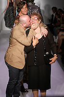 Fashion designer Danilo Gabrielli walks the runway with his mother, at the close of his Danilo Gabrielli Spring Summer 2012 fashion show, at Nolcha Fashion Week Spring 2012.