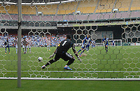 Guatemala midfielder Marco Papa (16) scores against Paraguay goalkeeper Justo VIllar (1) from a penalty kick.  Guatemala tied Paraguay 3-3 in a international friendly match at RFK Stadium, Wednesday August 15, 2012.