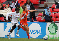 COLLEGE PARK, MD - OCTOBER 28, 2012:  Shade Pratt (22) of the University of Maryland races after Ashley Flinn (5) of Miami during an ACC  women's tournament 1st. round match at Ludwig Field in College Park, MD. on October 28. Maryland won 2-1 on a golden goal in extra time.