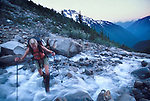Crossing a stream on the approach to Boston Basin in the North Cascades National Park.