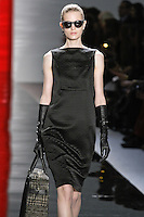 Magdalena walks runway in a ebony brick sleeveless silk cloque wedge dress, from the Reem Acra Fall 2012 Feminine Power collection fashion show, during Mercedes-Benz Fashion Week New York Fall 2012 at Lincoln Center.