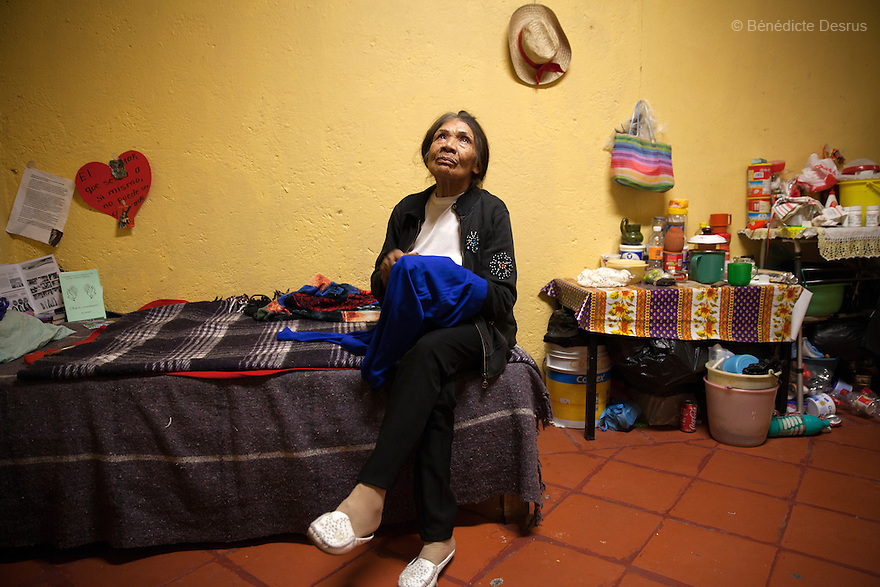 Portrait of Agustina, a resident of Casa Xochiquetzal, in her bedroom at the shelter in Mexico City, Mexico on June 19, 2013. Casa Xochiquetzal is a shelter for elderly sex workers in Mexico City. It gives the women refuge, food, health services, a space to learn about their human rights and courses to help them rediscover their self-confidence and deal with traumatic aspects of their lives. Casa Xochiquetzal provides a space to age with dignity for a group of vulnerable women who are often invisible to society at large. It is the only such shelter existing in Latin America. Photo by Bénédicte Desrus