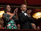 United States President Barack Obama and First Lady Michelle Obama applause at the beginning of a show for the Kennedy Center Honorees at the Kennedy Center, December 4, 2016, Washington, DC.  The 2016 honorees are: Argentine pianist Martha Argerich; rock band the Eagles; screen and stage actor Al Pacino; gospel and blues singer Mavis Staples; and musician James Taylor.<br /> Credit: Aude Guerrucci / Pool via CNP