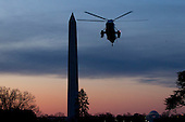 Marine One carrying United States President Barack Obama and the first family, arrives on the South Lawn of the White House in Washington, D.C., U.S., on Tuesday, January 3, 2012. The first family arrived after a 10-day vacation in Hawaii. .Credit: Andrew Harrer / Pool via CNP