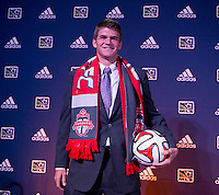 #10 overall pick Nick Haglund of Toronto FC stands on the podium during the MLS SuperDraft at the Pennsylvania Convention Center in Philadelphia, PA, on January 16, 2014.