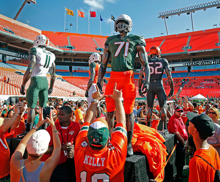 The Hurricanes unveil new uniforms before the start of the University of Miami spring football scrimmage at Sun Life Stadium in Miami Gardens onSaturday, April 12, 2014.