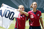 24 July 2005: US Captain Kate Markgraf (right) presents teammate Tiffeny Milbrett with a special jersey to commemmorate her 100th international goal in a pregame ceremony. The United States defeated Iceland 3-0 at the Home Depot Center in Carson, California in a Women's International Friendly soccer match..