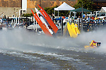 2004 Bay City River Roar, Bay City, Michigan, 26-27 June, 2004..Frame 1:.Chris Fairchild (L, #62) and Terry Rinker (R,#10) come together during the inverted start for Saturday's 2 heat race. Both boats suffer a blowover, Fairchild's boat landing upside down in the river only to be run over by Todd Bowden. During Rinkers crash, his boat snagged a pier with the lower unit, ripping it away. The boat continued skyward, hitting the staircase from the lower to the upper pier and then striking a piling with the right rear of the hull, with that large chunk falling to the pier below (to be seen in a later picture. Rinker continued his backflip, finally landing just a few feet from a docked pleasure boat filled with spectators. No one was injured in the accident and both drivers made the restart in their backup boats...&copy;F. Peirce Williams 2004..F. Peirce Williams .photography.P.O. Box 455 Eaton, Ohio 45320 USA.p: 317.358.7326 e: fpwp@mac.com