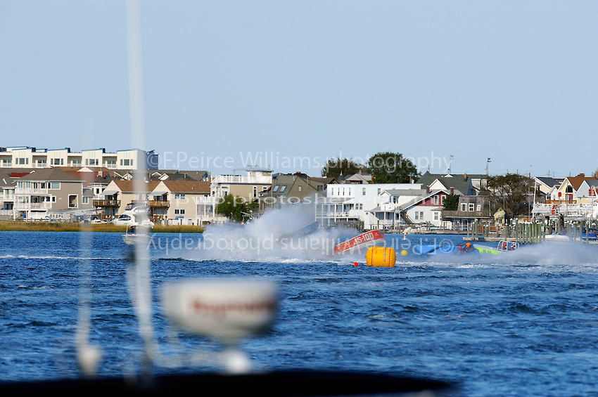 """Frame 3: JS-100 """"Summer Storm"""" (Jersey Speed Skiff) jumps sideways in the first turn and collides with JS-62 and JS-66 """"Yellow Jacket"""" . No one was seriously injured in the accident which had to be red flagged."""