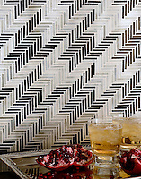 Houndstooth, a handmade mosaic backsplash shown in Jasper and Alabaster jewel glass, is part of the Houndstooth Collection by Sara Baldwin for New Ravenna.<br />