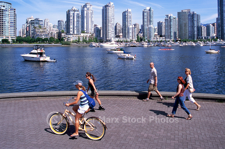 Vancouver, BC, British Columbia, Canada - City Skyline at False Creek and Yaletown, People cycling and walking on Seawall, Summer
