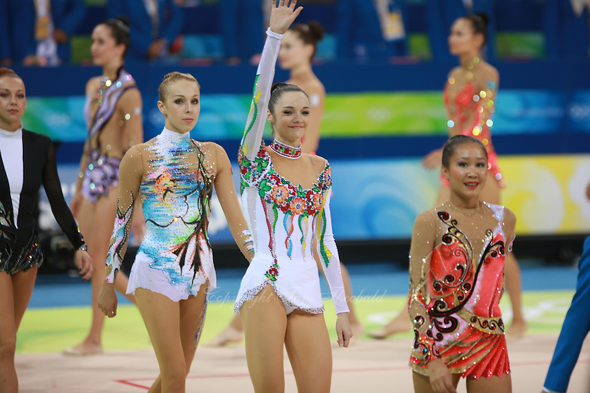 August 22, 2008; Beijing, China; Rhythmic gymnasts march-out after qualifying round at 2008 Beijing Olympics. (L-R) Natalya Godunko (barely in frame), Inna Zhukova, Anna Bessonova, Aliya Garaeva..
