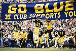 Michigan Wolverines coach Bo Schembechler leads his team onto the Michigan Stadium field before the Homecoming Game against the Iowa Hawkeyes in Ann Arbor, Michigan on 10/22/83.  The Wolverines defeated the Hawkeyes 16-13.  Photo by John D. Hanlon, 25-year photographer for Sports Illustrated.