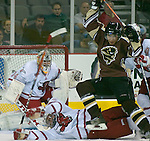 10/10/06 University of Nebraska at Omaha goalie  Jerad Kaufmann watches the puck through the action in front of the net during  an exhibition game against Manitoba..(Chris Machian/Prairie Pixel Group)..