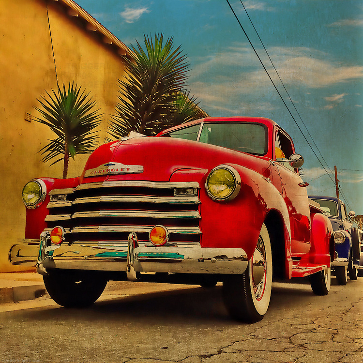 Red pickup truck parked on the street