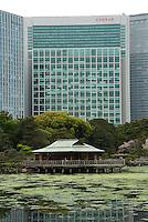 Hamarikyu Garden's Nakajima-no-chaya tea house with the Conrad hotel in the background, Tokyo, Japan.
