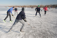 People skate on the frozen Lake Velence at Agard in Agard (about 55 kilometers South West of capital city Budapest), Hungary on January 15, 2017. ATTILA VOLGYI