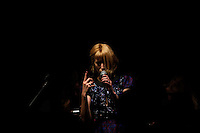 New york, United States. 7th February 2013 -- A singer performs next to the catwalk while models display creations by Timo Weiland during New York Fashion Week, MBFW 2013 in New York. Photo by Kena Betancur / VIEWpress.