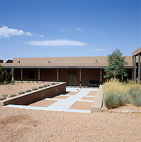 This modern home has been built in the historic Pueblo adobe style and is situated in the New Mexico prairies
